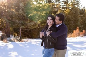 Littleton couple photographer family in love engagement session engaged future husband and wife marriage snow winter Colorado mountains mountain view golden hour sunset cute laughter