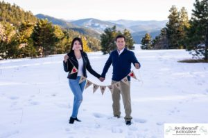 Littleton couple photographer family in love engagement session engaged future husband and wife marriage snow winter Colorado mountains mountain view golden hour sunset cute