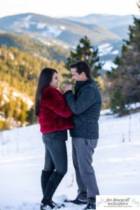 Littleton couple photographer family in love engagement session engaged future husband and wife marriage snow winter Colorado mountains mountain view golden hour sunset cute kiss kissing kisses