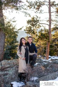 Littleton couple photographer family in love engagement session engaged future husband and wife marriage snow winter Colorado mountains mountain view golden hour sunset cute rocks