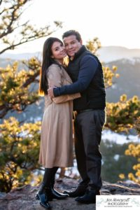 Littleton couple photographer family in love engagement session engaged future husband and wife marriage snow winter Colorado mountains mountain view golden hour sunset cute pretty light and ring