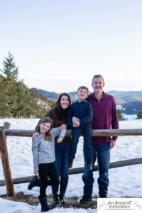 Littleton family photographer in Colorado with snow at Mt. Falcon park big sister little brother sweet mountain view