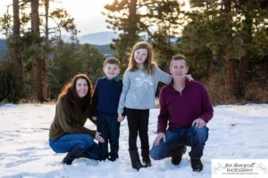 Littleton family photographer in Colorado with snow at Mt. Falcon park big sister little brother sweet mountain view at sunset golden hour