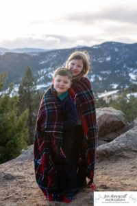 Littleton family photographer in Colorado with snow at Mt. Falcon park big sister little brother sweet