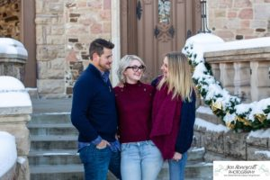 Littleton family photographer at the Highlands Ranch Mansion in Colorado with extended grandparents cousins snow winter Christmas cold teen baby boy