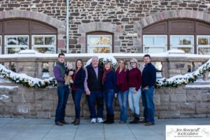 Littleton family photographer at the Highlands Ranch Mansion in Colorado with extended grandparents cousins snow winter Christmas cold teen baby