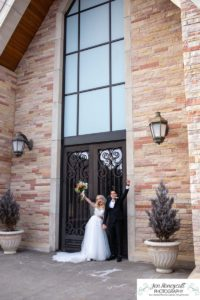 Littleton wedding photographer in Colorado at Cherry Hills Community church Highlands Ranch foothills Christ centered Christian bride groom husband wife married marriage love getting ready long white dress tuxedo bridesmaids groomsmen winter reception young college father mother son daughter stained glass beautiful ring suspenders navy blue pretty flowers