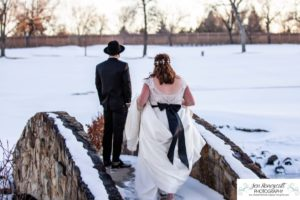 Littleton wedding photographer in Colorado at the Lakewood Country Club and golf course bride groom winter snow stone bridge fedora hat marriage married cake white dress in love family ceremony first look