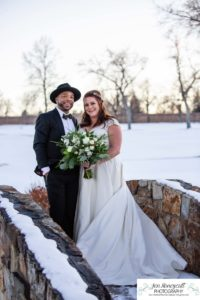 Littleton wedding photographer in Colorado at the Lakewood Country Club and golf course bride groom winter snow stone bridge fedora hat marriage married cake white dress in love family ceremony husband and wife