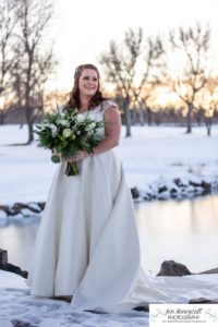 Littleton wedding photographer in Colorado at the Lakewood Country Club and golf course bride groom winter snow stone bridge fedora hat marriage married cake white dress in love family ceremony sunset