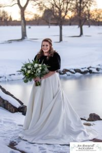 Littleton wedding photographer in Colorado at the Lakewood Country Club and golf course bride groom winter snow stone bridge fedora hat marriage married cake white dress in love family ceremony fur shawl