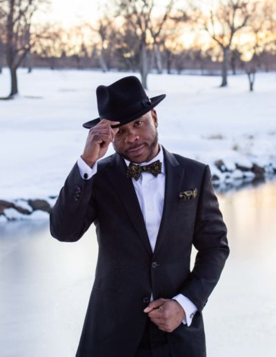 Littleton Colorado wedding photographer groom fedora hat snow winter Lakewood Country Club and golf course marriage