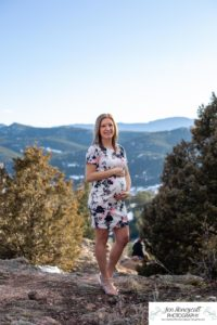 Littleton family maternity photographer in Colorado Mt. Falcon park snow spring baby bump pregnant husband and wife mountain view mountains foothills sunset natural golden light