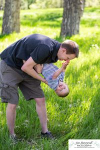 Littleton family photographer maternity baby bump belly Lakewood Stone House Bear Lake Greenbelt trail trees little boy momma to be parenthood parents cute father son playing