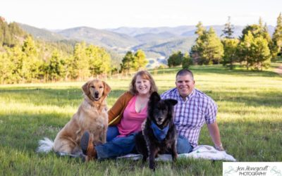 Brian and Abbey with their two dogs at Mt. Falcon park by a Littleton family photographer