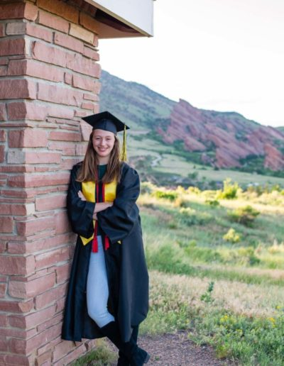 Littleton high school senior photographer portrait photography cap and gown red rocks teen graduate graduation class of 2020 honors smart college