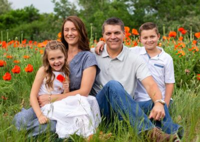 Littleton family photographer in Colorado poppy field wildflowers Morrison private neighborhood red rocks mother father daughter son summer red natural light
