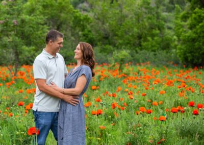 Littleton family photographer in Colorado Morrison poppy field couples in love married marriage husband and wife