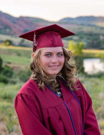 Littleton high school senior photographer in Colorado Chatfield Jefferson County open graduate graduates class of 2020 college bound red rocks Mt. Falcon park Morrison cap and gown photo session girls boy tassle summer graduation