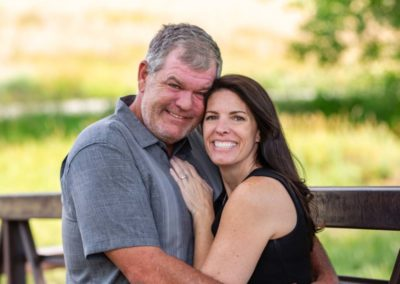 Littleton family wedding photographer in Colorado couple in love engagement photo session engaged husband and wife man woman Lakewood Heritage Center diamond ring yes future