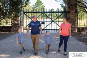 Littleton family photographer Highlands Ranch Mansion Colorado boys kids children summer natural light old stone house building love masks COVID virus walking brothers outdoors