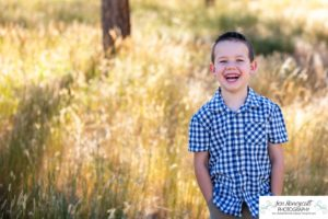 Littleton family photographer Highlands Ranch Mansion Colorado boys kids children summer natural light old stone house building love masks COVID virus brothers