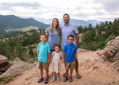 Littleton family photographer in Colorado at Mt. Falcon park foothills mountain view views boys girls sister brother sunset natural light photography