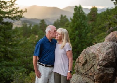 Littleton family photographer married couple in love anniversary marriage husband and wife Colorado mountains sunset view Mt. Falcon park natural light