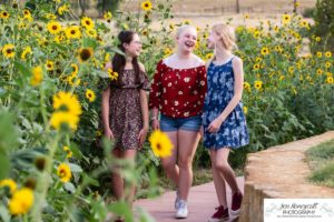 Littleton family and teen photographer Colorado South Valley Open Space park Ken Caryl red rocks rock formations best friends girls high school freshman teenagers COVID-19 pandemic photo session natural light photography walking sunflowers