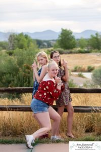 Littleton family and teen photographer Colorado South Valley Open Space park Ken Caryl red rocks rock formations best friends girls high school freshman teenagers COVID-19 pandemic photo session natural light photography sunflower field sunflowers pretty silly