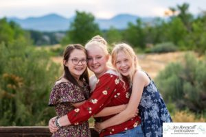 Littleton family and teen photographer Colorado South Valley Open Space park Ken Caryl red rocks rock formations best friends girls high school freshman teenagers COVID-19 pandemic photo session natural light photography pretty hugs