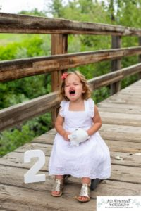 Littleton family photographer Writer's Vista park toddler baby girl wooden bridge two years old Colorado photography tantrum real life