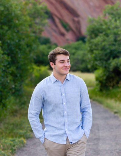 Littleton high school senior photographer in Colorado at Roxborough State park red rocks rock formations boy football lacrosse athletic Highlands Ranch Mountain Vista teen teenager Audubon Society college bound natural light photography
