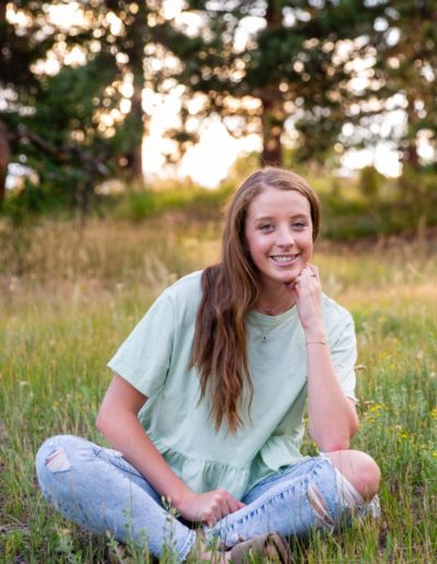 Littleton high school senior photographer in Colorado at Mt. Falcon park Chatfield Charger swimmer swim team girl teen teenager natural light photography portrait session mountain view views foothills pretty beautiful college bound future