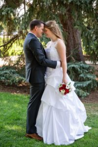 Littleton wedding photographer in Colorado at the War Memorial Rose Garden Bemis summer ceremony gazebo red roses bride groom in love bridesmaids groomsmen dress white COVID outdoors natural light