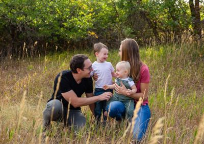 Littleton family photographer at Roxborough State Park in Colorado red rocks rock formations fall summer boys brothers mother father son sons one year old three years love natural light photography