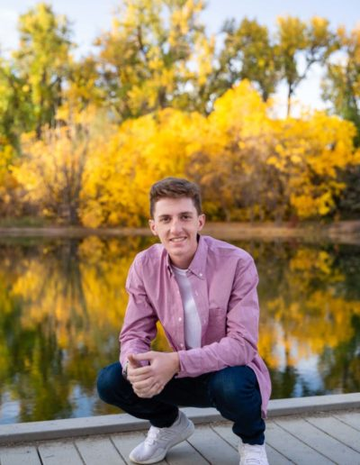 Littleton high school senior photographer at Fly'N B park in Highlands Ranch Colorado Castle Rock college bound baseball player boy bat glove handsome natural light photography sunrise session