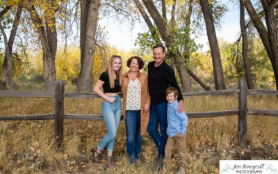 The {S} family for a fall family photo session along the Platte River by Littleton photographer
