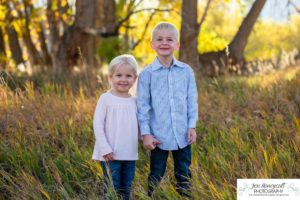 LIttleton family photographer boy girl Ken Caryl Valley red rocks rock formations fall photo session brother sister mother father parenthood sweet siblings sunset natural light photography Bradford Perley house