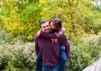 Littleton family photographer Fly'N B park Highlands Ranch Colorado CO in love couple couples fall leaves piggy back ride