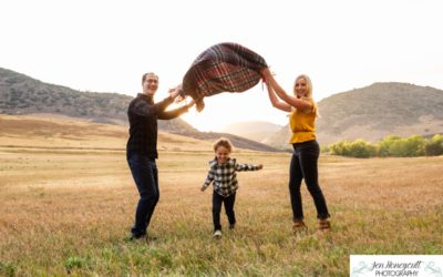 The {L} family of 3 at Hildebrand Ranch for a fall photo session by local Littleton photographer