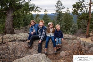 Littleton family photographer in Colorado at Mt. Falcon park Indian Hills Parmalee Gulch trail four kids children brother sister mother father boys girls cute sweet beautiful handsome mountains fall photo shoot natural light photography
