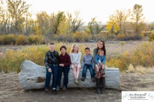 Littleton family photographer Carson Nature Center Platte River fall photo session yellow leaves six kids children mother father boys girls brothers sisters toddler foothills Colorado sunset natural light photography