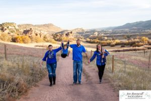 Littleton family photographer South Valley Open Space park in Ken Caryl Colorado fall photo session boy girl son daughter brother sister little big baby mother father grandparents red rocks rock formations sunset