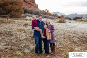 Littleton family photographer in Colorado South Valley Open Space park Ken Caryl red rocks rock formations boys brothers fall photo session cold frost winter mother father sons sunset photography