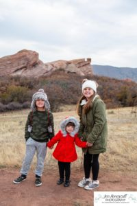 Littleton family photographer South Valley Open Space park Colorado red rocks rock formations kids sisters brother girls boy three winter coats and hats couple in love married sunset natural light photography