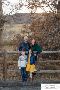 Littleton family photographer Hildebrand Ranch Colorado farm barn boy girl siblings brother sister mother father sunset golden natural light photography foothills view children kids broken arm