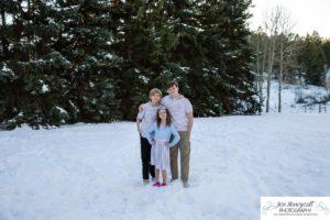 Littleton family photographer snow photo session Morrison pine trees snowy winter Thanksgiving extended grandmother grandchildren visit from Arizona
