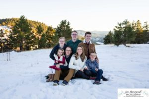 Littleton family photographer in Colorado at Mt. Falcon park snow fall winter kids children big brother little sister mountain view views foothills snow