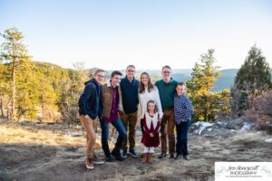 Littleton family photographer in Colorado at Mt. Falcon park snow fall winter kids children big brother little sister mountain view views foothills